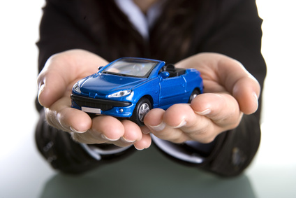 businesswoman holding car in the hands - insurance or car busine
